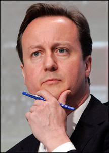 UK Prime Minister David Cameron rubbing his chin.